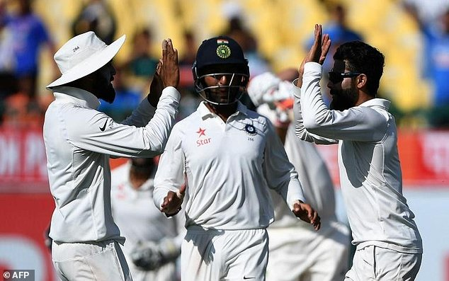 India's Ravindra Jadeja (right) celebrates the wicket of Australia's Pat Cummins on the third day of the fourth Test in Dharamsala on March 27, 2017